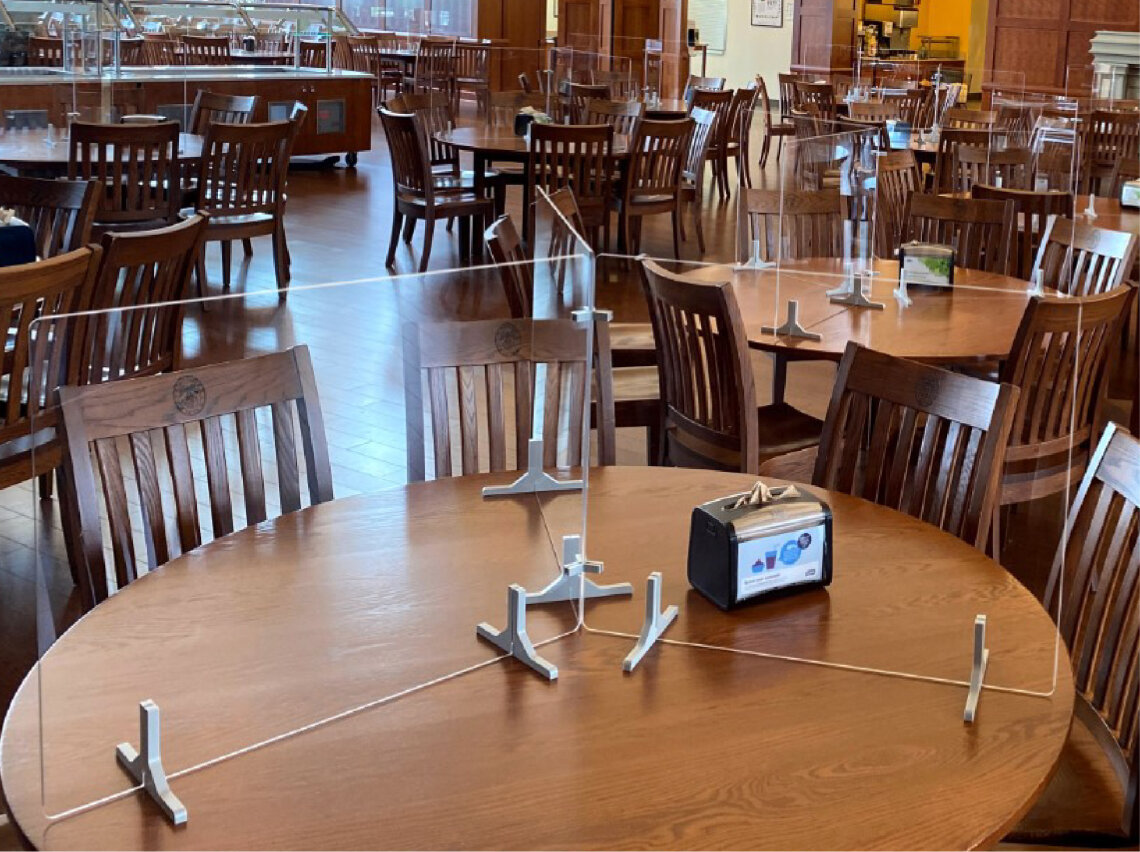 Clear Adjoin panels divide round tables in public dining area