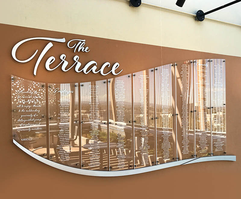 """The Terrace"" multi-panel glass donor wall"