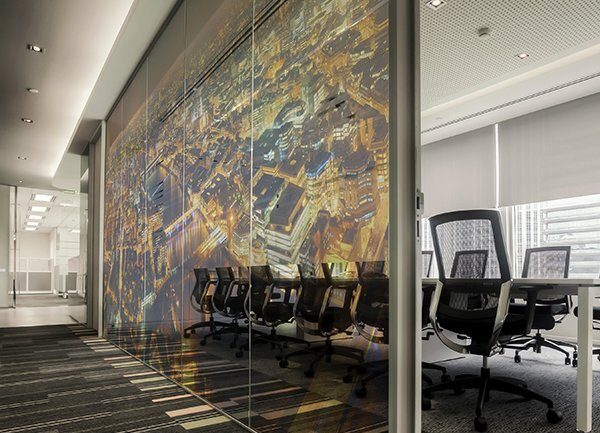 Conference room with dramatic nighttime ariel photo of city skyline applied on optically clear window film.