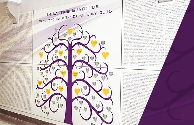 Moxie donor wall featuring purple tree in elementary school