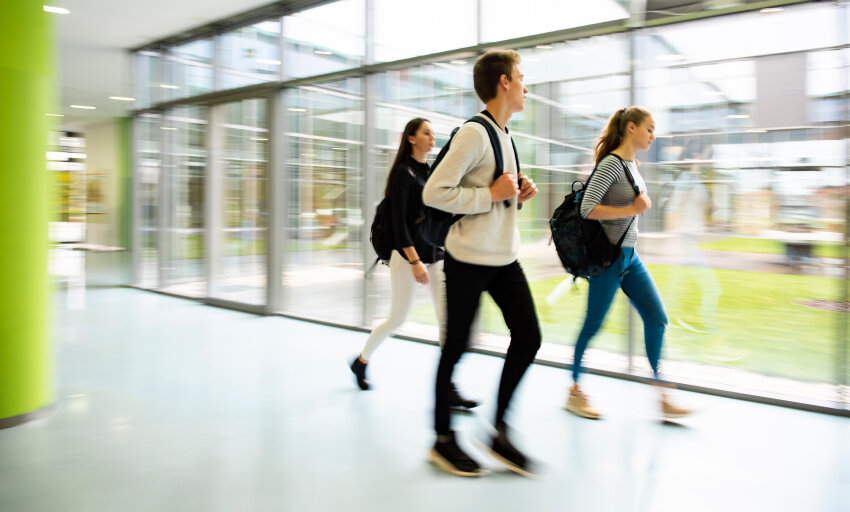 Return back-to-school solutions feature image of college kids walking