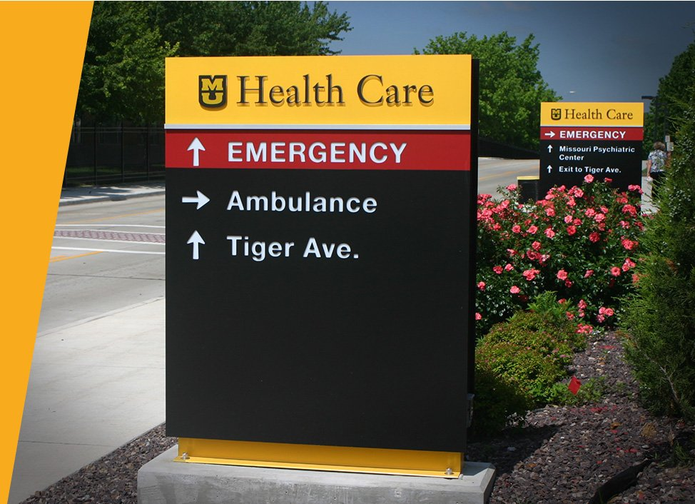 Exterior hospital directional sign on Takeform's premium footer with stainless socket cap screws.