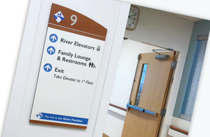 Interior wall sign with arrows in hospital
