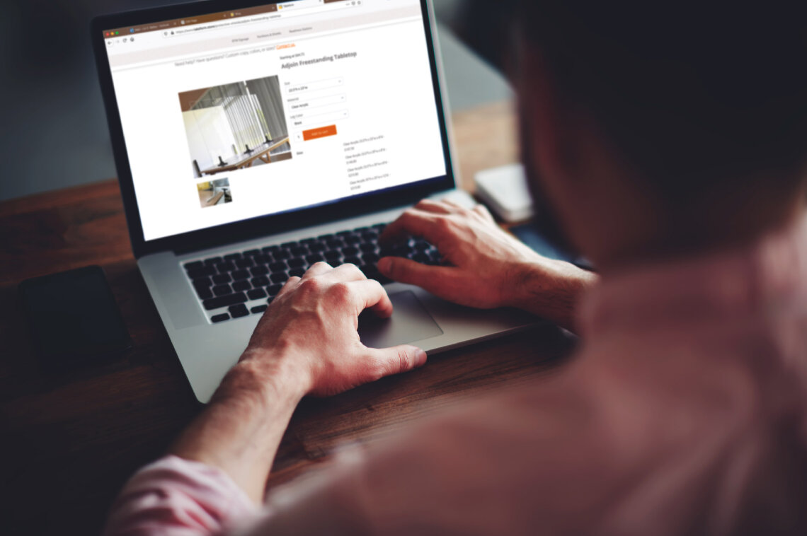 Over the shoulder of a man shopping at Takeform's Online Store