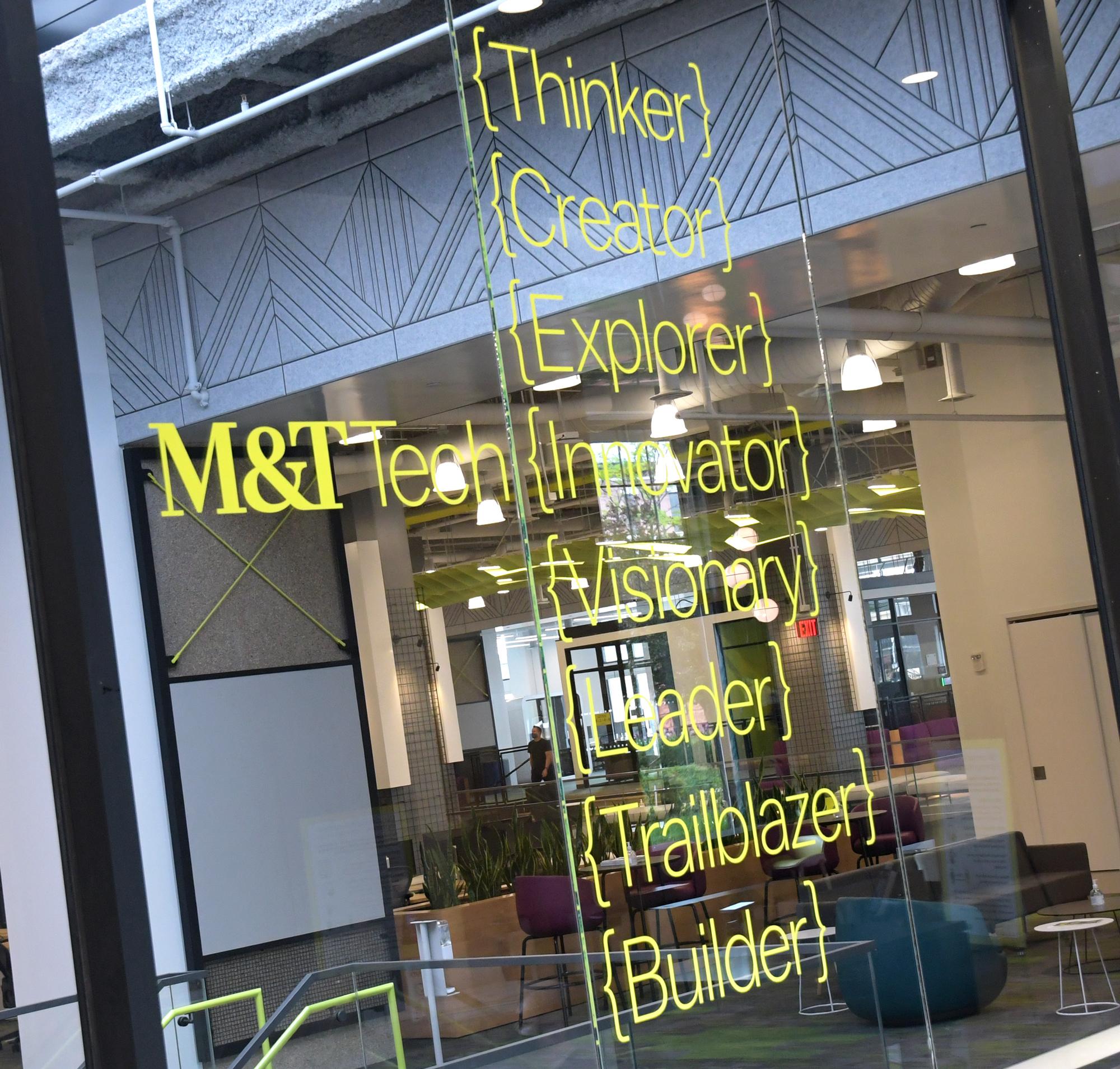 Photo of window adhesive wording using M and T branding