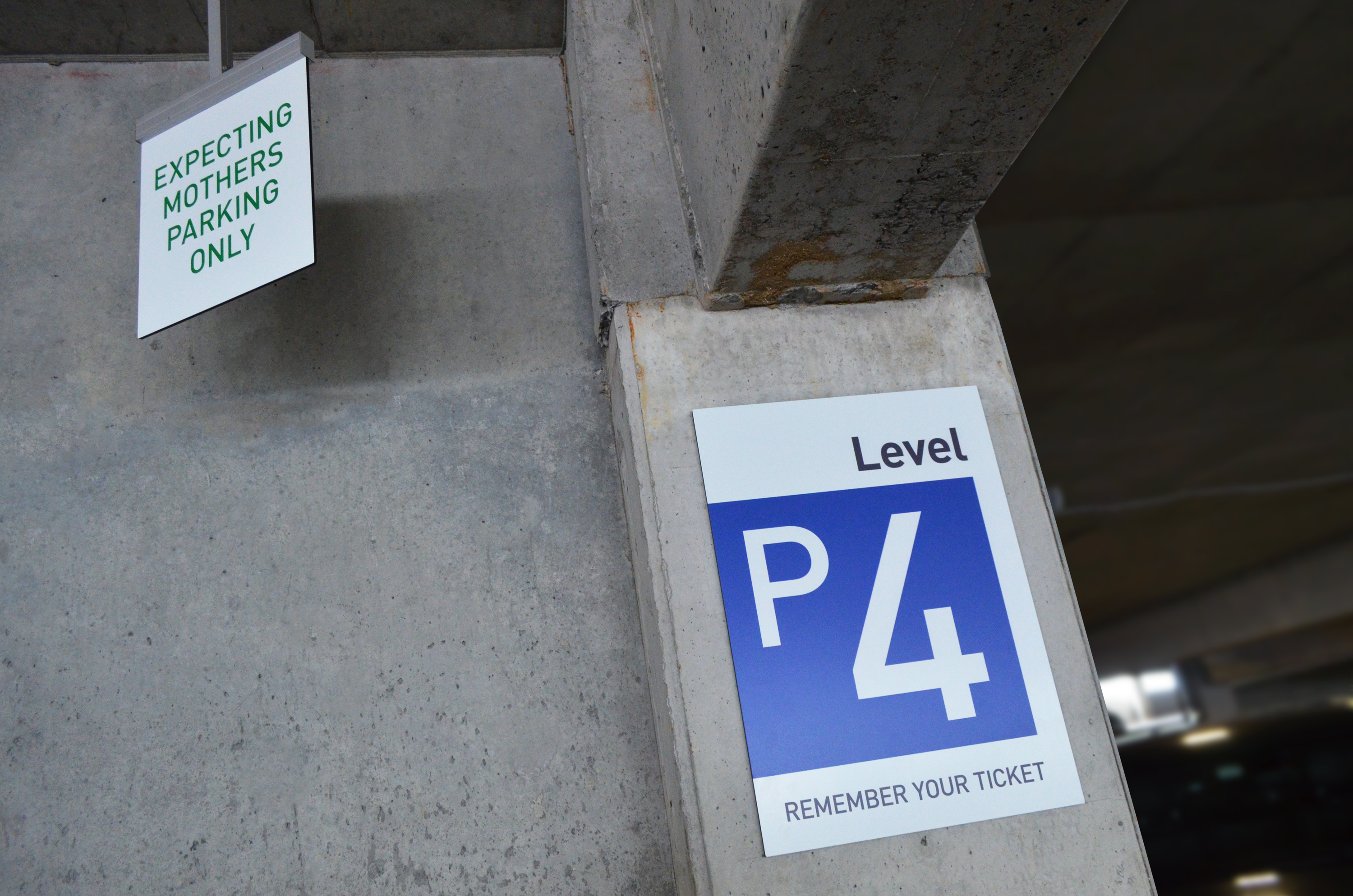 Photo of a post Suspended Overhead mounted sign in parking garage