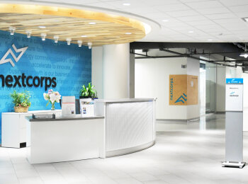 Photo of Ethos lettering at NextCorps front desk