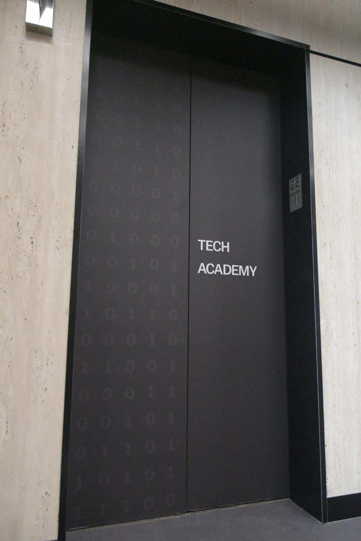 Photo of elevator with binary code design on doors