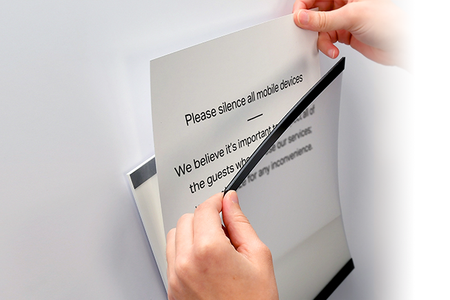 Easy-to-use magnetic notice holders declutter your space and protect the document