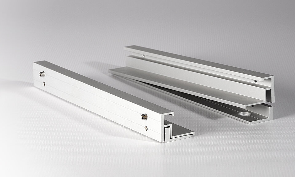 Lucid aluminum rail hardware features matte anodized natural finish and concealed hardware.