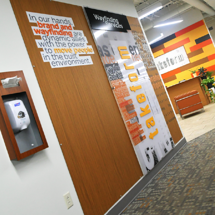 Branded moxie panel installation at Takeform's headquarters