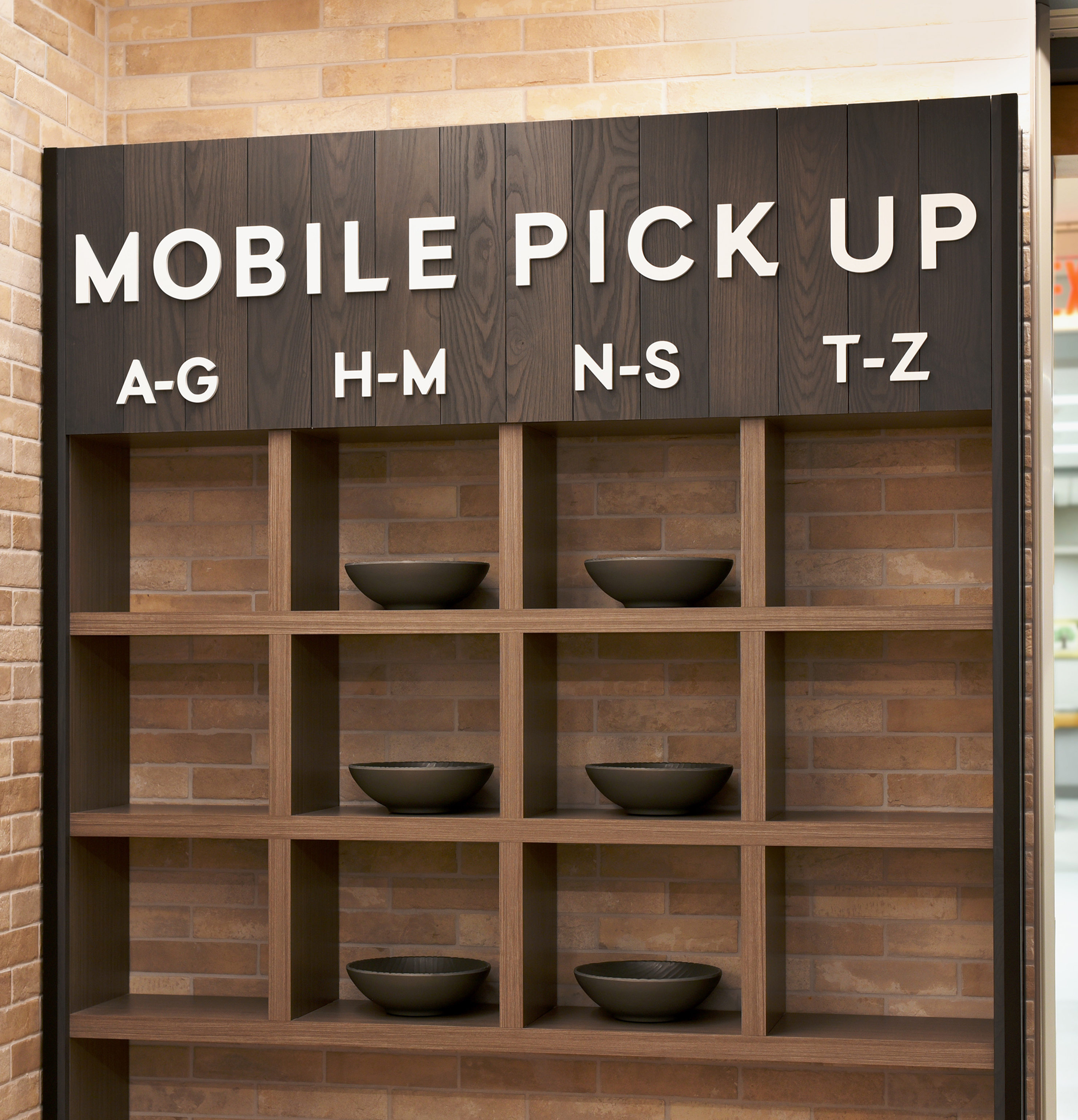 Mobile phone station with ethos lettering