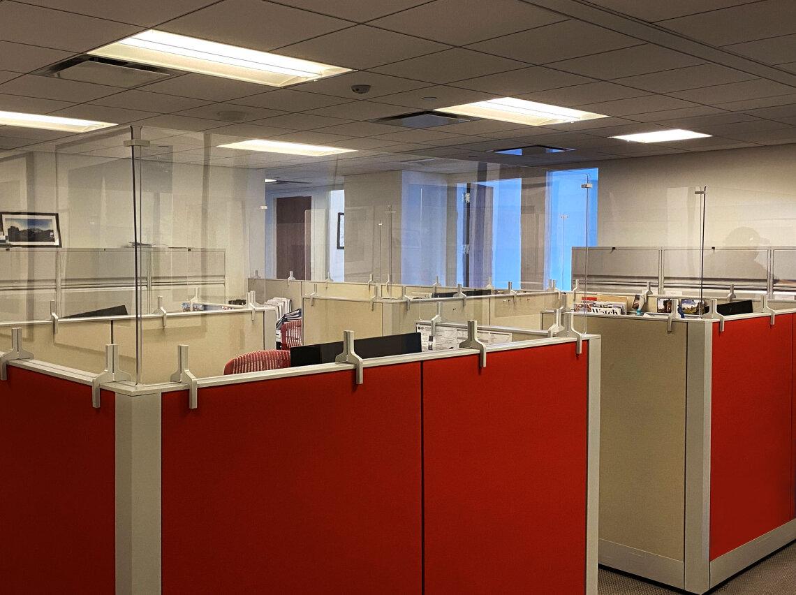 Clear Acrylic Panels fit the tops of red office cubicles