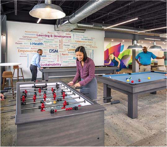 Busy office break room with bright and colorful experiential graphics
