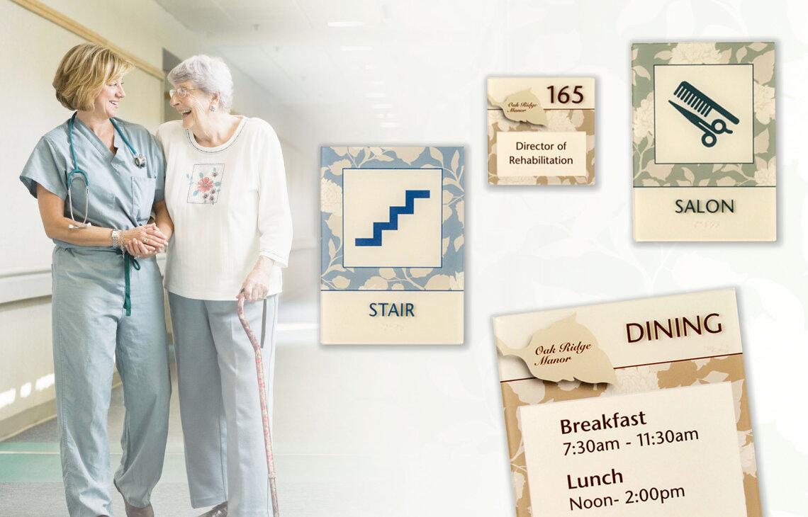 Nurse happily helps senior resident walk down hallway of group home