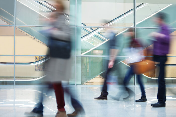 People moving through a building corridor–motion blur