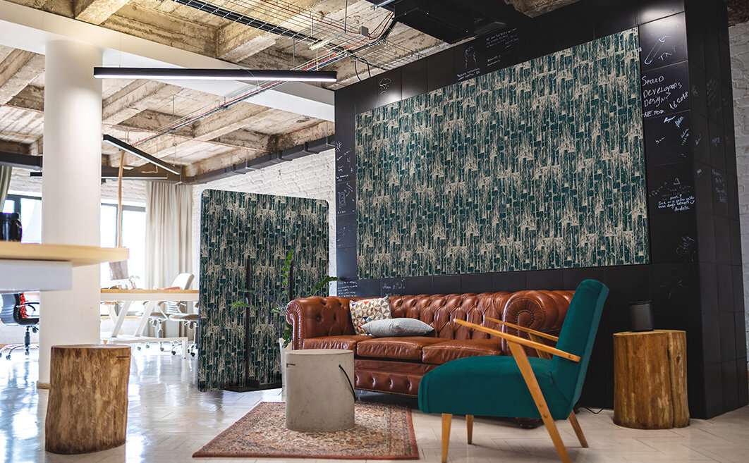 Contemporary loft studio office with acoustic freestanding partition and wall panels with designer direct-print patterns