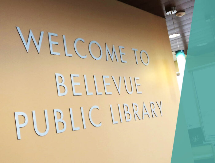 Dimensional letters behind Library Front Desk