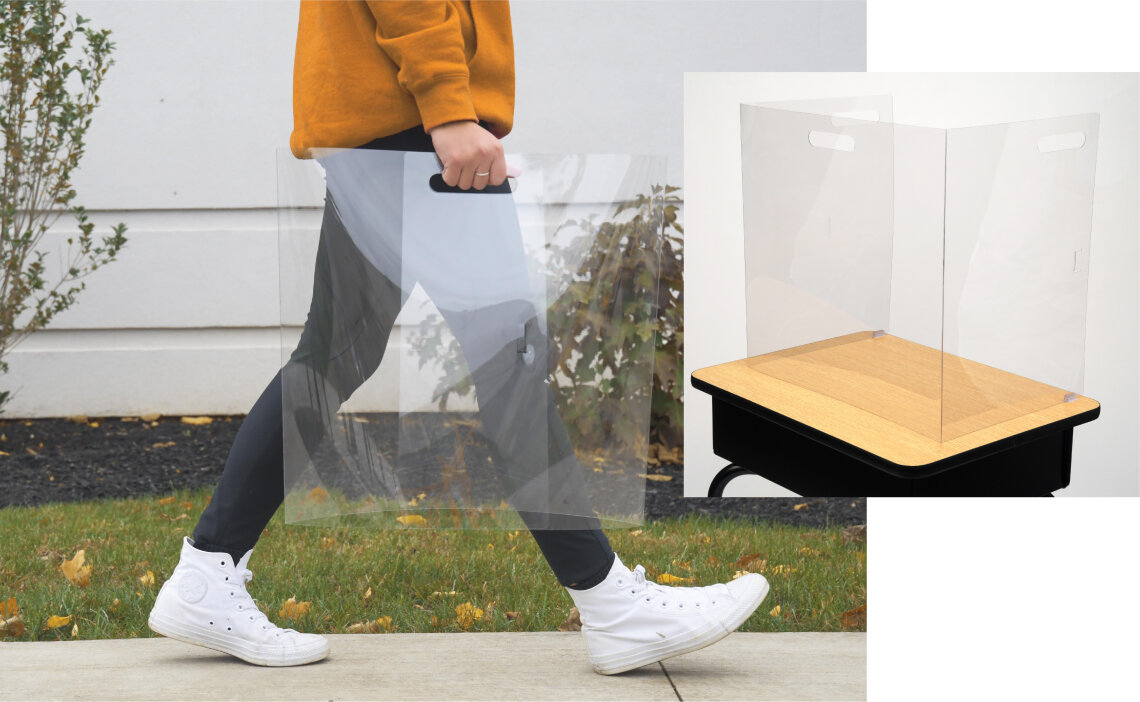Sideview of student walking on sidewalk carrying portable FunView Desktop with ease