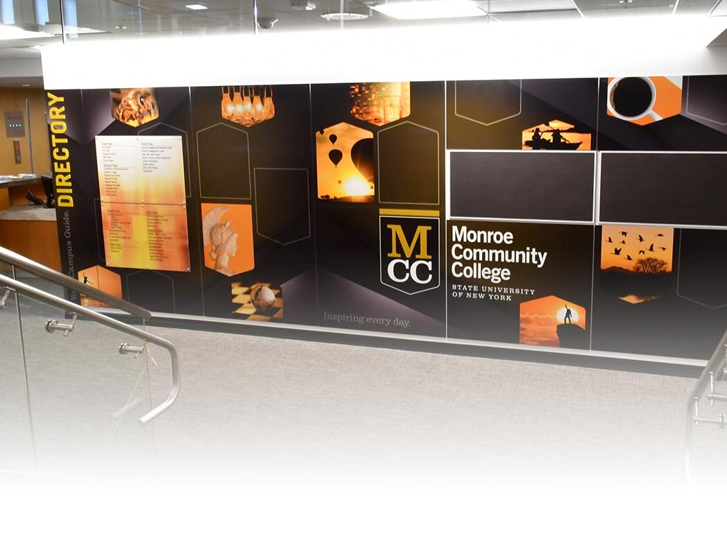 Graphic panel installation in front lobby of urban college campus