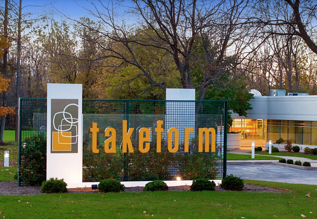 Takeform's exterior monument sign in front of corporate office at dawn