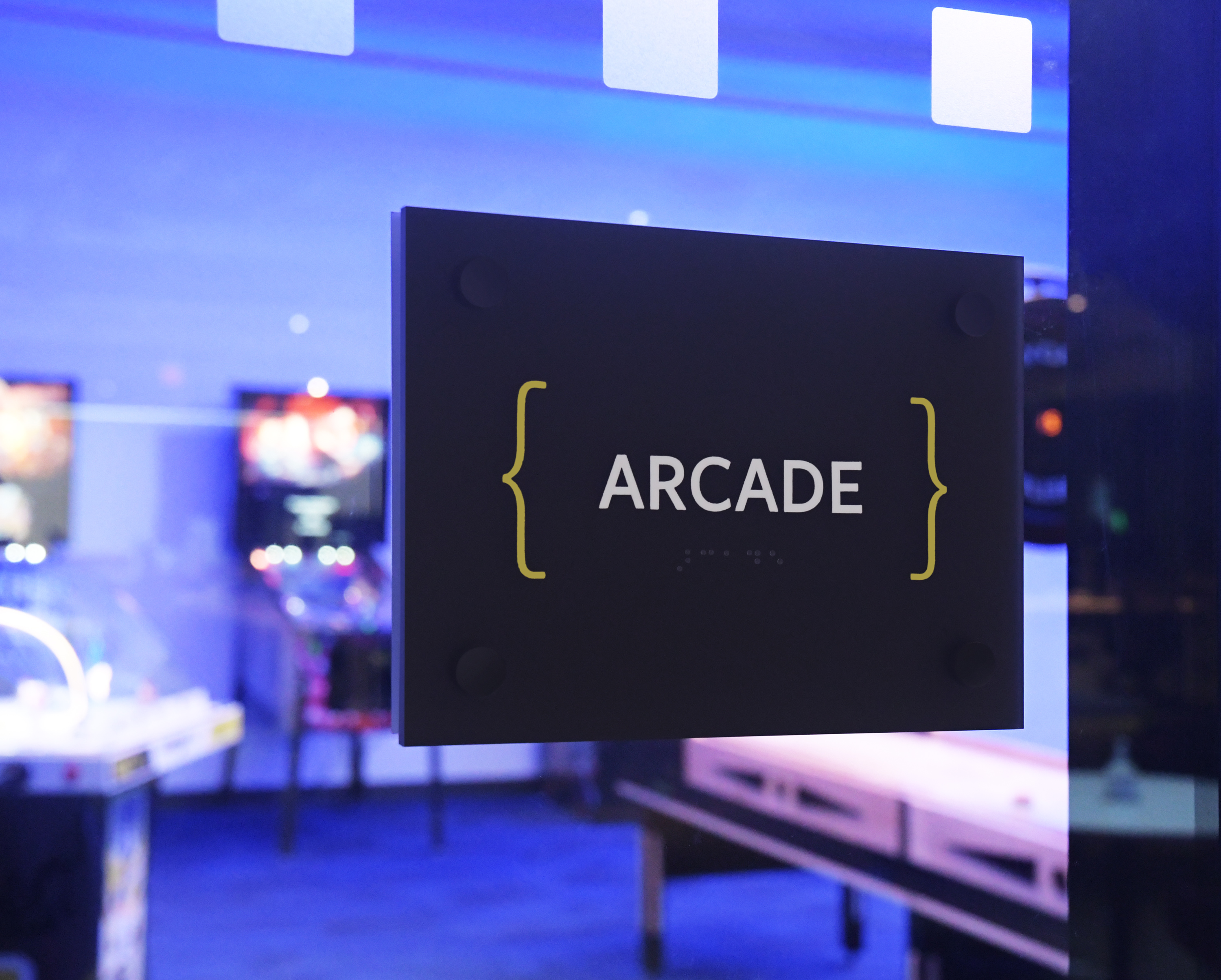 Photo of arcade room with room sign and Ethos lettering