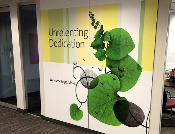 "Branded space featuring interior wall graphics for Mindtree Limited. Contemporary design with natural elements and the statement: ""Unrelenting dedication"""