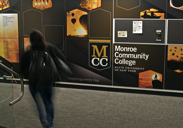 Young student walking down stairs in MCC Urban Campus
