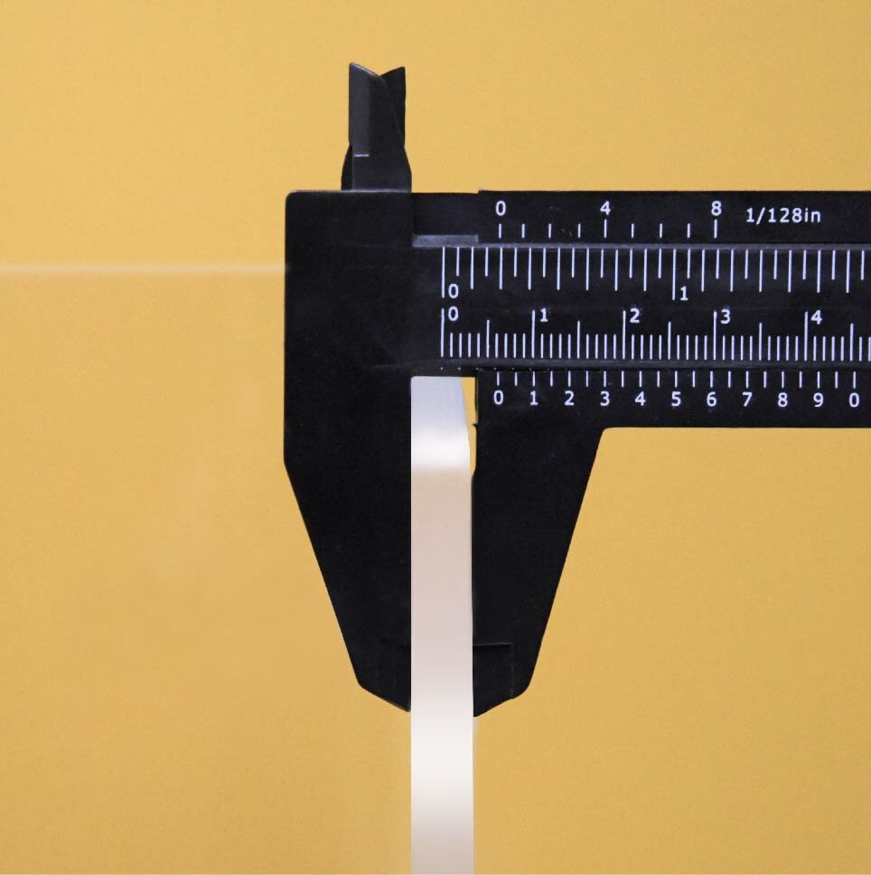 Calipers measuring thickness of Adjoin 3-Sided Screens