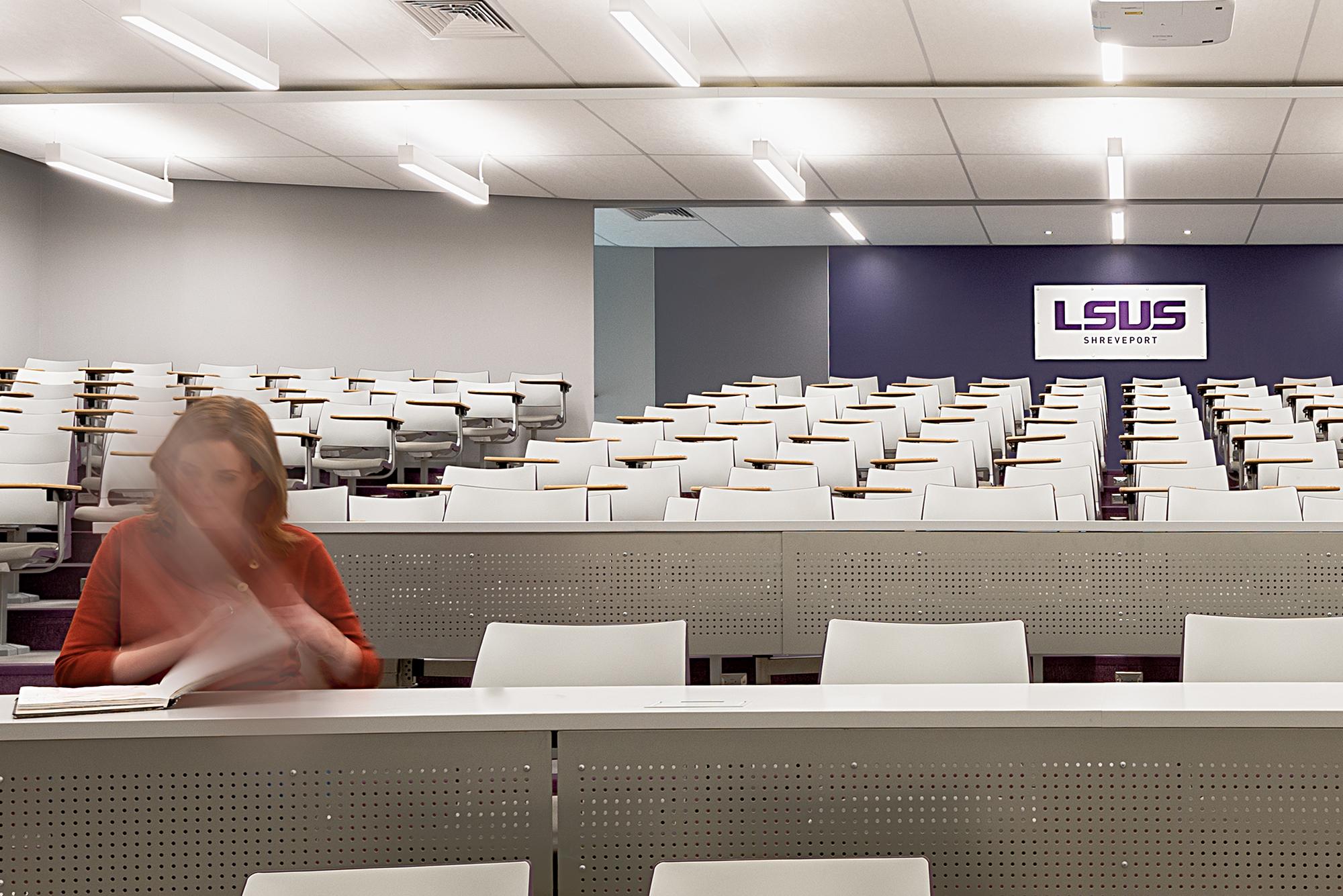 LSUS auditorium with student