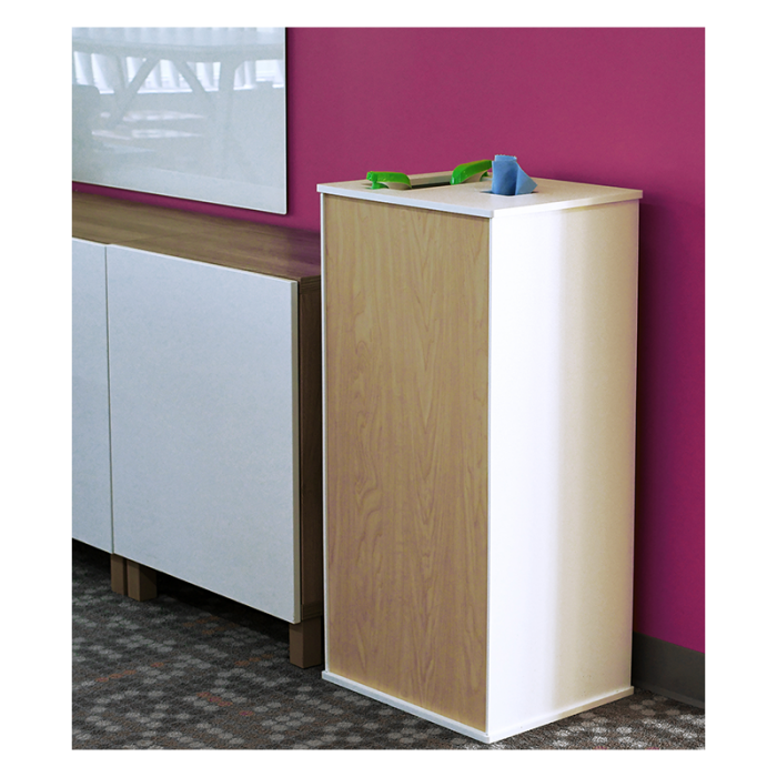 Freestanding Pedestal model Cleaning Station sitting beside cabinet in front of purple wall