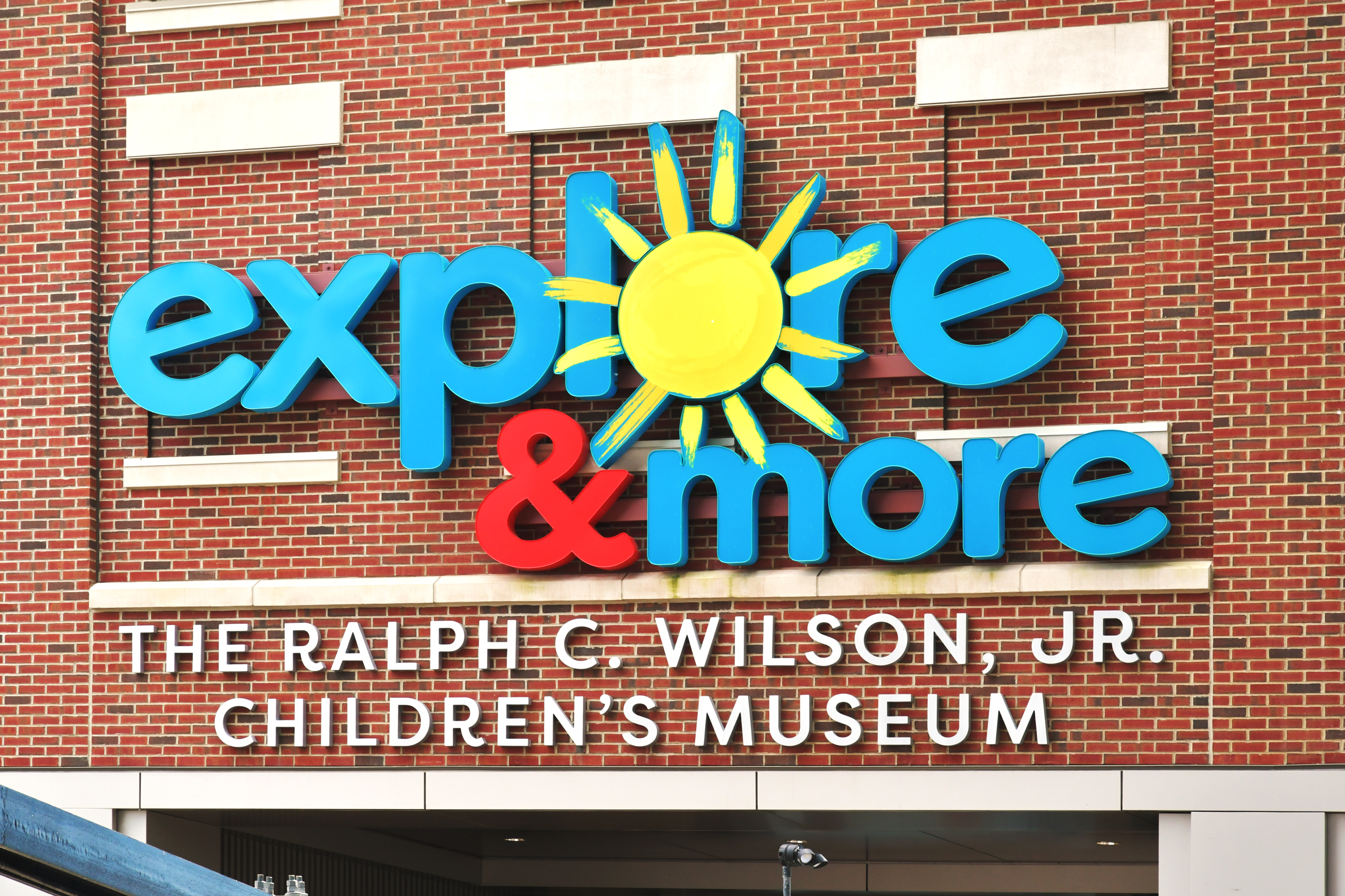 Exterior entrance sign for Explore and More