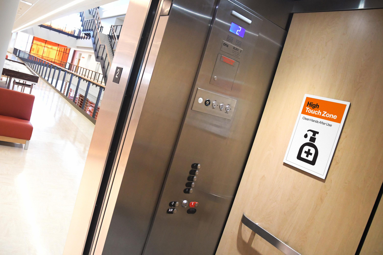 RIT Return signage in elevator photo