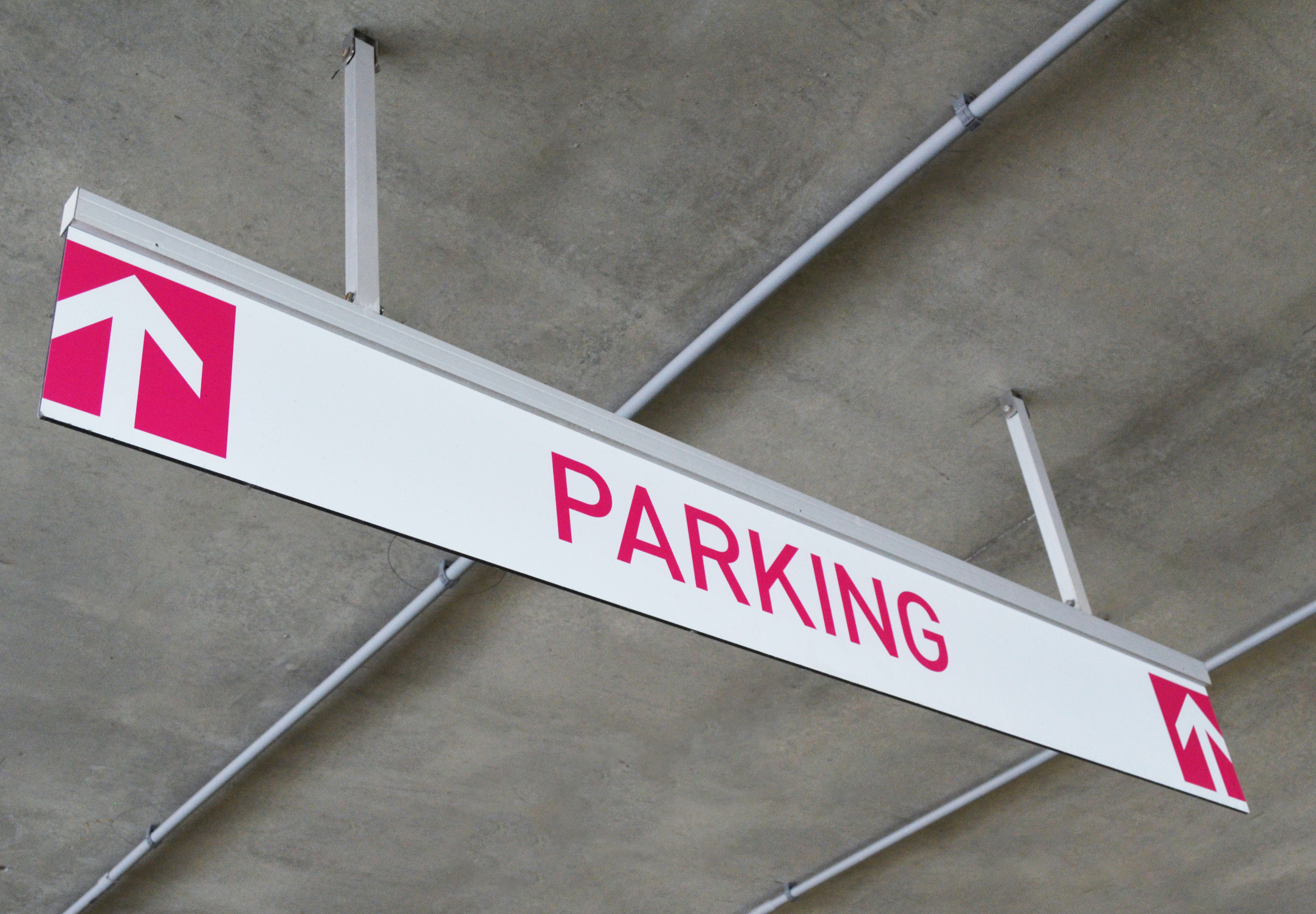 Photo of Post Suspended Overhead mounted Transit signage at parking garage