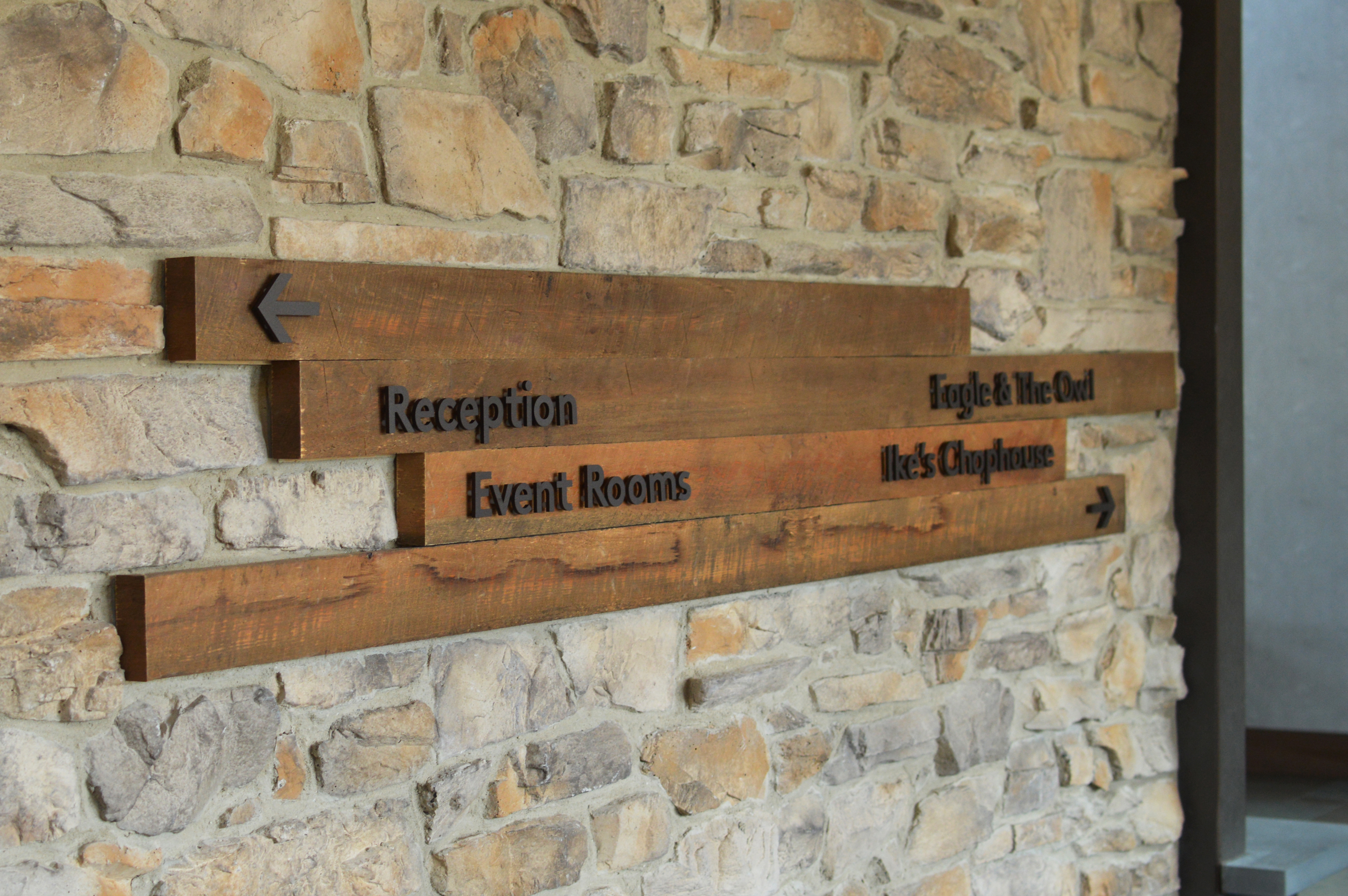 Photo of Ethos lettering on wood at Liberty Mountain Resort lobby