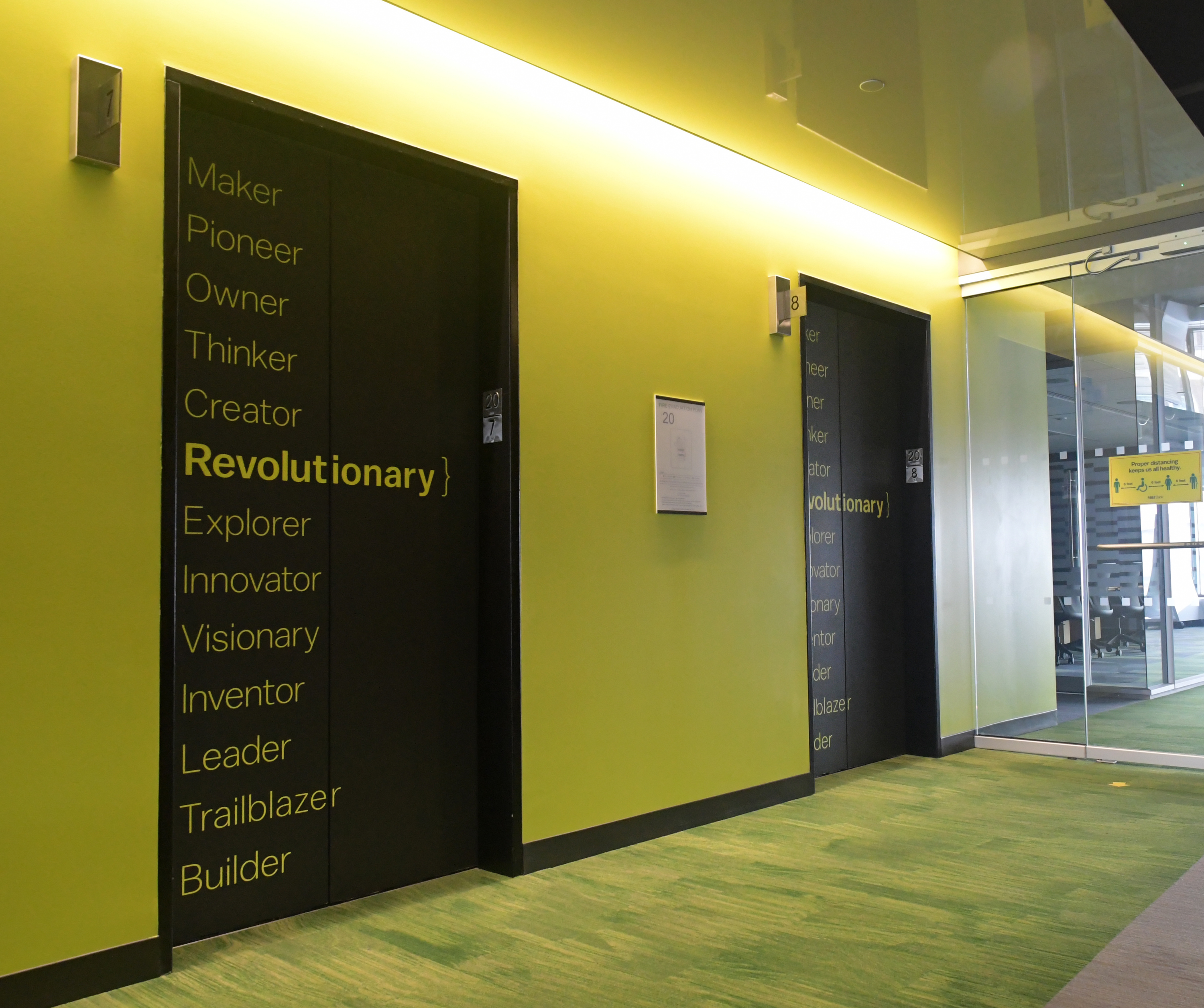 Photo of Amplify lettering on elevator doors