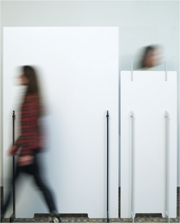 Photo of two people walking on opposite sides of freestanding partition
