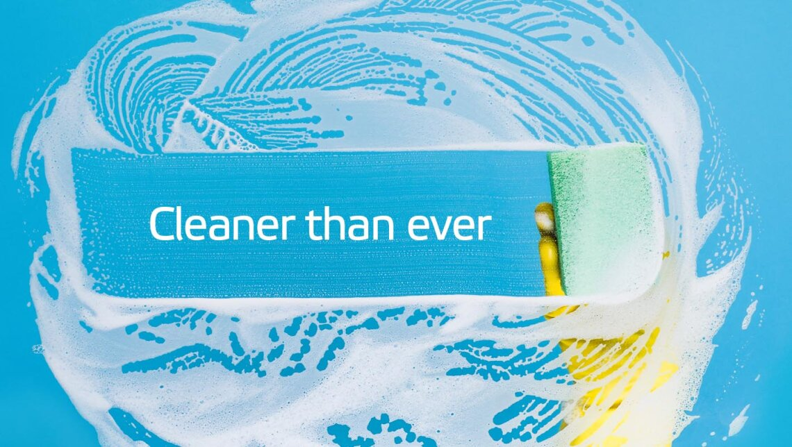 Cleaner than ever – a sponge wipes away suds over blue background