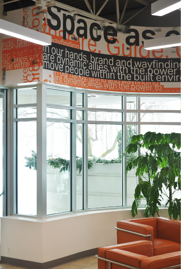 Amplify wall covering for Takeform's headquarters in the rafters of entryway