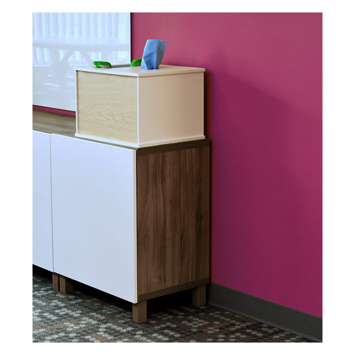 Countertop model Cleaning Station on cabinet in front of purple wall