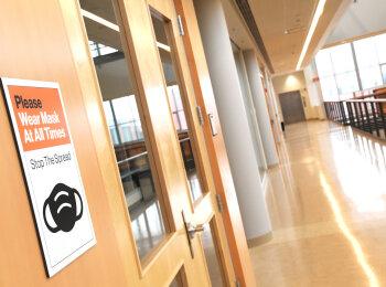 RIT Return sign in hallway