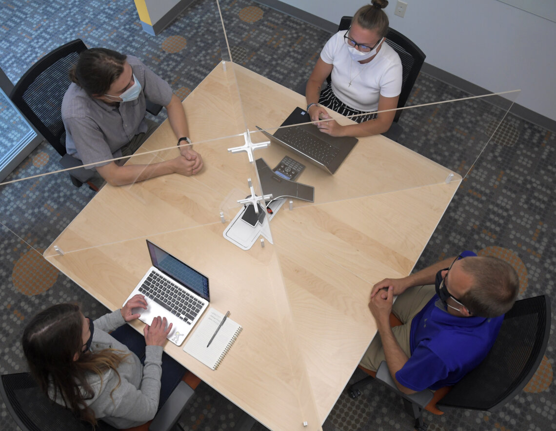 Tabletop partition on square meeting room table