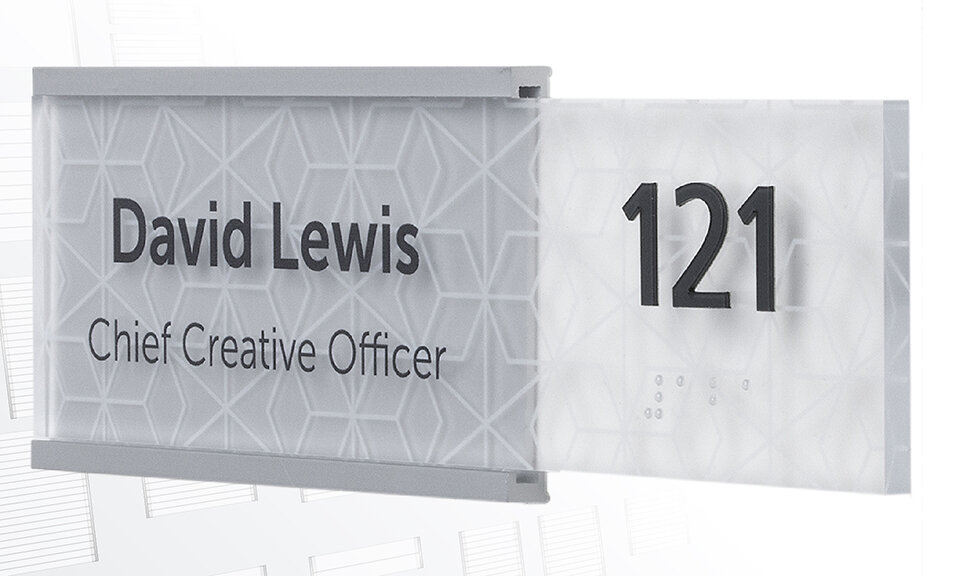 Lucid room identification signage configuration featuring c-channle hardware, extended tile, black copy, and subtle geometric direcy-print pattern.