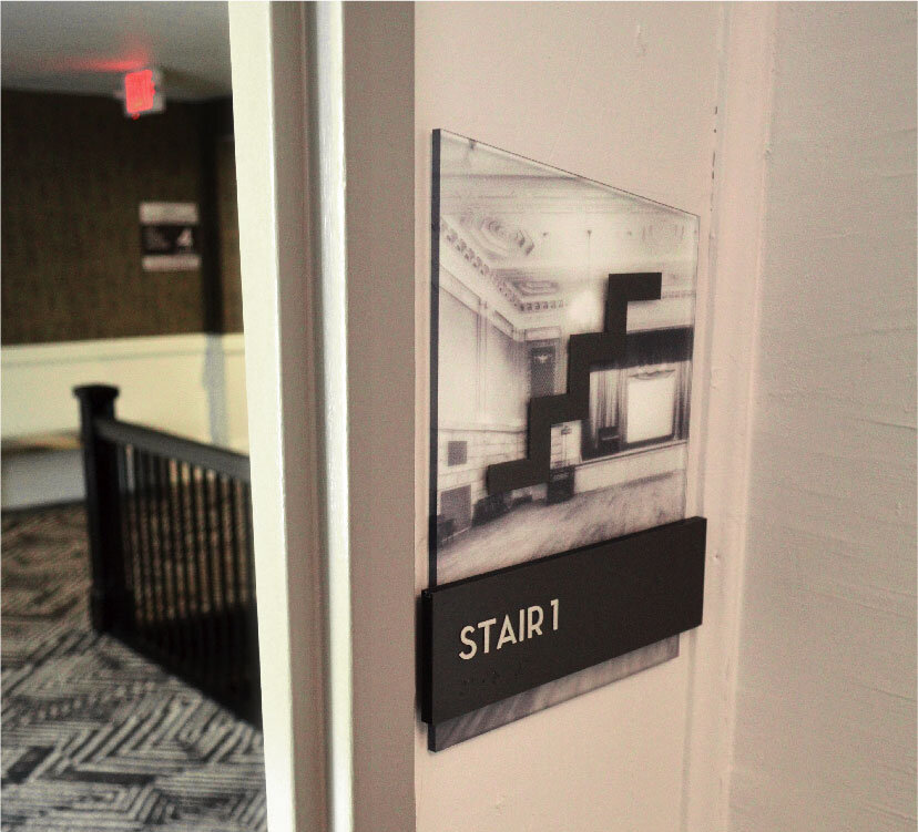 Stairwell sign for Aloft Hotel in Buffalo, NY